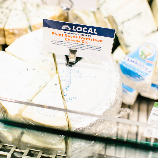 Local Cheese from Point Reyes Farmstead Cheese Company in the cheese department of a New Leaf Community Markets