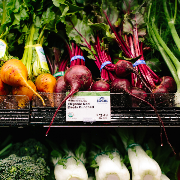 Local beets in the produce section of a New Leaf Community Markets