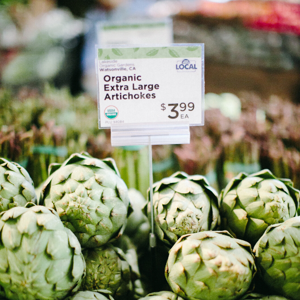 Organic Artichoke grown locally in California in the produce section of a New Leaf Community Markets
