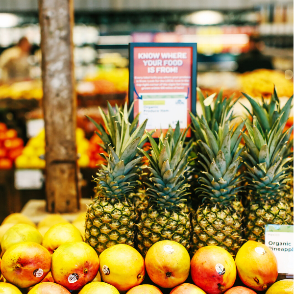 Organic Pineapple and Citrus in the produce section of New Leaf Community Markets in Santa Cruz, California