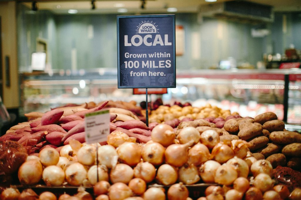 Onions, russet potatoes, sweet potatoes, yams, and more all grown within 100 miles of New Leaf Community Markets stores