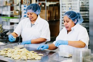 New Leaf Partner Fund Recipients making ravioli in their kitchen
